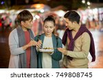 group of vietnamese young... | Shutterstock . vector #749808745