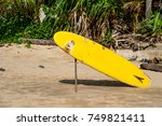 yellow board on the beach for... | Shutterstock . vector #749821411