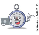 with laptop compass character... | Shutterstock .eps vector #749829115