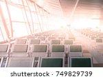 empty aluminium seats at an... | Shutterstock . vector #749829739