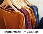 clothes on clothes rail in... | Shutterstock . vector #749830285