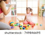 mother see her daughter play... | Shutterstock . vector #749846695