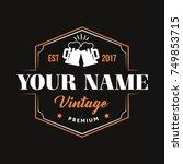 vintage logo with beer cheers... | Shutterstock .eps vector #749853715