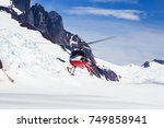 helicopter landing on a remote... | Shutterstock . vector #749858941