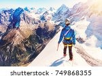 climber  reaches the summit of... | Shutterstock . vector #749868355