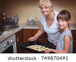 happy grandmother with cute... | Shutterstock . vector #749870491