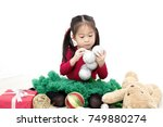 asian little girl wearing red... | Shutterstock . vector #749880274