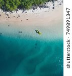 Aerial view of a beach, creek, sea, beautiuful blue and trees. Kayak on the beach view from a drone - stock photo