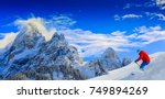 skiing with amazing panorama of ... | Shutterstock . vector #749894269