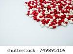 red  white antibiotic capsules...   Shutterstock . vector #749895109