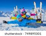happy family enjoying winter... | Shutterstock . vector #749895301
