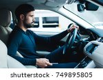 tired of traffic jam. side view ... | Shutterstock . vector #749895805