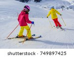 woman skiing with daughter on...   Shutterstock . vector #749897425