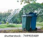 row of wheelie bins and opening ... | Shutterstock . vector #749905489
