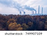 smoke over forest and power... | Shutterstock . vector #749907109