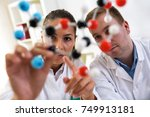 two students of chemistry... | Shutterstock . vector #749913181
