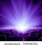 viewers watch shining light at... | Shutterstock . vector #749936701