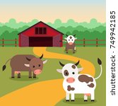 cows graze near the farm ...   Shutterstock .eps vector #749942185