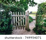 Wooden Gate On Path With Hedges