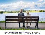 two boys sit on a bench  by the ... | Shutterstock . vector #749957047