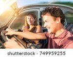 couple in a car at sunset  with ... | Shutterstock . vector #749959255
