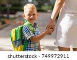 smiling schoolboy holding...   Shutterstock . vector #749972911