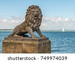 a stone lion sits proudly on... | Shutterstock . vector #749974039