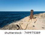 old bollard on rocky coast of... | Shutterstock . vector #749975389