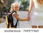content schoolgirl holding... | Shutterstock . vector #749977465
