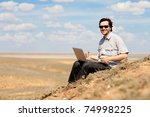 man with laptop outdoors | Shutterstock . vector #74998225