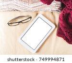 glasses and white tablet on...   Shutterstock . vector #749994871