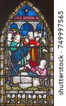 Small photo of LONDON, GREAT BRITAIN - SEPTEMBER 19, 2017: The Jesus Heals lame man on the stained glass in St Mary Abbot's church on Kensington High Street.