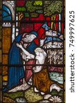 Small photo of LONDON, GREAT BRITAIN - SEPTEMBER 19, 2017: The parable of the Prodigal Son on the stained glass in St Mary Abbot's church on Kensington High Street.