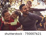 parents carrying little girls... | Shutterstock . vector #750007621