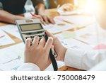 businesswoman holding... | Shutterstock . vector #750008479