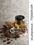 Small photo of Tea with cinnamon and almonds