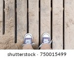 top view on child's feet in... | Shutterstock . vector #750015499