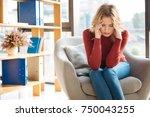 strong headache. unhappy... | Shutterstock . vector #750043255