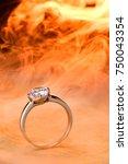 diamond ring. jewelry fire... | Shutterstock . vector #750043354