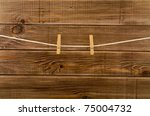 Clothespins On A Wooden...