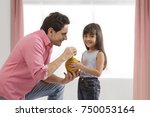 father and daughter inserting...   Shutterstock . vector #750053164