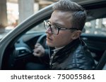close up. a young handsome man... | Shutterstock . vector #750055861