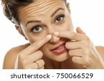 a young woman squeezes the... | Shutterstock . vector #750066529