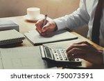 accountant working on desk... | Shutterstock . vector #750073591