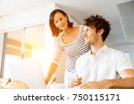 happy modern couple working on... | Shutterstock . vector #750115171