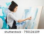 concentrated girl focused on... | Shutterstock . vector #750126109