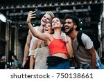 happy friends taking selfie at... | Shutterstock . vector #750138661