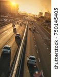 cars on highway. sunset... | Shutterstock . vector #750145405