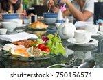 breskfat set with fried eggs... | Shutterstock . vector #750156571