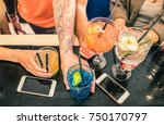 friends group drinking cocktail ... | Shutterstock . vector #750170797